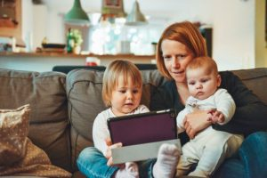Children and mother using ipad